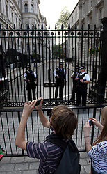 21 April 2011. London, England..Armed police officers guard the Prime Minister and other senior politicians at  Downing Street off Whitehall, part of the Royal wedding route where the procession will pass through en route to Buckingham Palace in the run up to Catherine Middleton's marriage to Prince William..Photo; Charlie Varley.