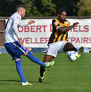 Chris Hussey tries to get the ball past Anthony Grant during the Sky Bet League 1 match between Bury and Port Vale at Gigg Lane, Bury, England on 19 September 2015. Photo by Mark Pollitt.