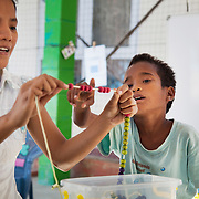 Dulce Lopes teach children counting and arithmetics through playing with  string with coloured beads. The Alola Foundation provide pre-school play and learn sessions. Education in Timor-Leste is very basic with classes up to 80 children and teachers trained under an old fashined system with very little inter-action between teacher and pupils..Fundasaun Alola is a not for profit non government organization operating in Timor Leste to improve the lives of women and children. Founded in 2001 by the then First Lady, Ms Kirsty Sword Gusmao, the organization seeks to nurture women leaders and advocate for the rights of women.