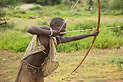 Young Hadza men practice hunting with bow and arrow. The Hadza, or Hadzabe, are an ethnic group in north-central tanzania, living around Lake Eyasi in the Central Rift Valley and in the neighboring Serengeti Plateau.