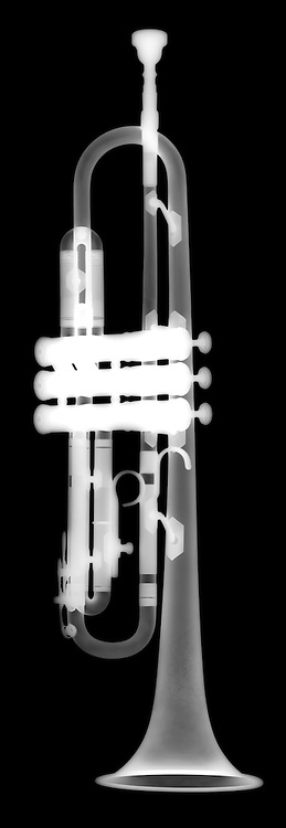 X-ray image of a trumpet (white on black) by Jim Wehtje, specialist in x-ray art and design images.