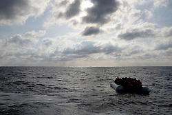 Migrants in a dinghy await rescue by the Migrant Offshore Aid Station (MOAS) around 20 nautical miles off the coast of Libya, June 23, 2016.  Picture taken June 23, 2016.<br /> REUTERS/Darrin Zammit Lupi <br /> MALTA OUT. NO COMMERCIAL OR EDITORIAL SALES IN MALTA