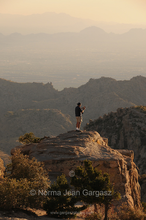 A tourist visits Windy Point Vista, Mount Lemmon, in the Santa Catalina Mountains, a Sky Island in the Coronado National Forest, Sonoran Desert, Tucson, Arizona, USA.