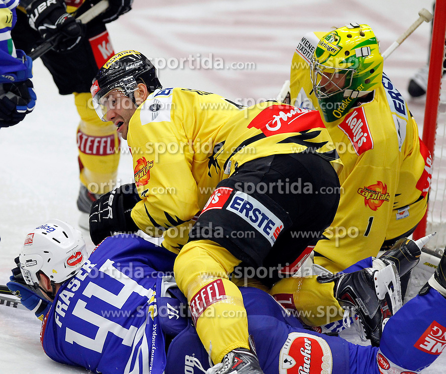 22.09.2013, Stadthalle, Villach, AUT, EBEL, EC VSV vs UPC Vienna Capitals, 9. Runde, im Bild Curtis Fraser (VSV,#44), Adrian Veideman (Capitals,#7) und Matthew Zaba (Capitals,#1) // during the Erste Bank Icehockey League 9th round between EC VSV vs UPC Vienna Capitals at the City Hall, Villach, Austria, 2013/09/22, EXPA Pictures © 2013, PhotoCredit: EXPA/ Oskar Hoeher