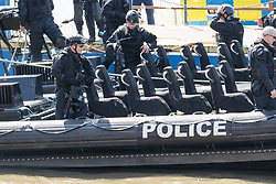 © Licensed to London News Pictures. 24/05/2017. LONDON, UK.  Marine Police Officers from the Metropolitan Police, including some armed officers board RIBs (Rigid Inflatable Boat) this morning as they leave their base on the River Thames.  The Marine Police Unit will be carrying out training exercises on the River Thames today, as the Metropolitan Police Serrvice has confimed it has increased police numbers in the capital in response to the increased terrorist threat. Photo credit: Vickie Flores/LNP