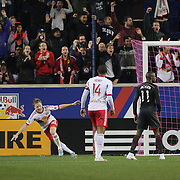 Dax McCarty, (left), New York Red Bulls, celebrates after scoring a goal beating goalkeeper Joe Bendik, Toronto FC, during the New York Red Bulls Vs Toronto FC, Major League Soccer regular season match at Red Bull Arena, Harrison, New Jersey. USA. 11th October 2014. Photo Tim Clayton