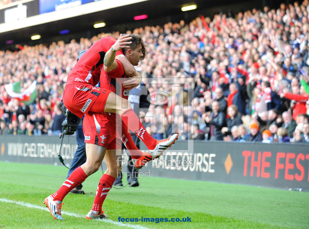 Rhys Webb of Wales (right) celebrates scoring their first try during the RBS 6 Nations match at Murrayfield Stadium, Edinburgh<br /> Picture by Greg Kwasnik/Focus Images Ltd +44 7902 021456<br /> 15/02/2015