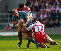 Photo: Richard Lane/Richard Lane Photography. Gloucester Rugby v Cardiff Blues. Anglo Welsh EDF Energy Cup Final. 18/04/2009. Blues' Gethin Jenkins is tackled by Gloucester's Gareth Delve and Nick Wood.