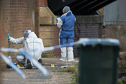 © Licensed to London News Pictures . 16/11/2015 . Liverpool , UK . Forensic examiners at the Leeds-Liverpool Canal in the Eldonian Village area of Liverpool where a 16 year old boy was shot dead last night (15th November 2015 ) . Photo credit: Joel Goodman/LNP