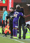 Charlton Athletic midfielder, Callum Harriott (11) and Charlton Athletic Head Coach Jose Riga hugging during the Sky Bet Championship match between Brentford and Charlton Athletic at Griffin Park, London, England on 5 March 2016. Photo by Matthew Redman.