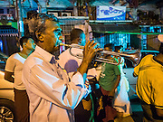 "22 OCTOBER 2015 - YANGON, MYANMAR: Hindu musicians participate in an evening procession to honor the goddess Durga on the last day of Navratri in the Sri Kali temple in Yangon. Navratri, literally ""nine nights"" is a Hindu festival devoted to the Goddess Durga. Navratri festival combines ritualistic puja (prayer) and fasting. Navratri in India follows the lunar calendar and is celebrated in September/October as Sharad Navratri. It's widely celebrated in countries in Southeast Asia that have large Hindu communities, including Myanmar (Burma). Many of Myanmar's Hindus are descendants of Indian civil servants and laborers who came to Myanmar when it was the British colony of Burma.   PHOTO BY JACK KURTZ"