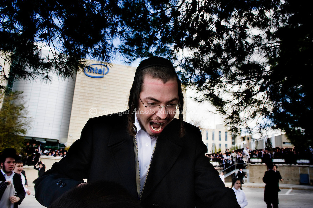 Ultra Orthodox Jews demonstrate outside the Intel plant in Jerusalem's Hozvim Mountain industrial area on November 14, 2009 to protest against the factory operating on the Jewish day of rest. Around 2,000 protesters chanted 'Shabbat, Shabbat' and called on Intel, the world's biggest maker of semiconductors, to keep the factory shut on the holy day, Jerusalem police spokesman Shmuel Ben Ruby, adding that there were no reports of violence..© ALESSIO ROMENZI
