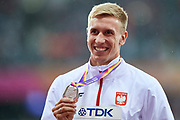 Great Britain, London - 2017 August 09: Piotr Lisek (OSOT Szczecin) of Poland celebrates his silver medal in men&rsquo;s pole vault while awarding ceremony during IAAF World Championships London 2017 Day 6 at London Stadium on August 09, 2017 in London, Great Britain.<br /> <br /> Mandatory credit:<br /> Photo by &copy; Adam Nurkiewicz<br /> <br /> Adam Nurkiewicz declares that he has no rights to the image of people at the photographs of his authorship.<br /> <br /> Picture also available in RAW (NEF) or TIFF format on special request.<br /> <br /> Any editorial, commercial or promotional use requires written permission from the author of image.