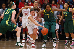 February 26, 2011; Stanford, CA, USA;  Stanford Cardinal guard Jeanette Pohlen (23) is fouled by Oregon Ducks guard/forward Deanna Weaver (1) while reaching for a loose ball during the first half at Maples Pavilion.