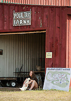 """Molly Snow and her Jumbo Pekin Duck """"Charles"""" relax outside the Poultry Barn at the Belmont Fairgrounds 4H Fair Sunday morning.  (Karen Bobotas/for the Laconia Daily Sun)"""