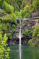 Ticino, Southern Switzerland. Lake, waterfalls and double-arched bridge.