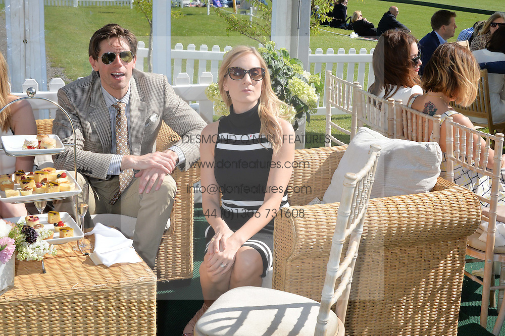 JOANNE FROGGATT and JAMES CANNON at the St.Regis International Polo Cup at Cowdray Park, Midhurst, West Sussex on 16th May 2015.