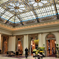 """Hotel Bellevue Palace Salon in Bern, Switzerland <br /> When you walk through the door of Hotel Bellevue Palace, you can see why they call it """"five stars with timeless elegance."""" You feel like one of the countless heads of states and royalty who have slept here. Black tie waiters serve their guests in beautifully appointed salons with stained glass canopies and thick dentil molding supported by Corinthian columns. Bellevue Palace was built in 1865 and reopened in 1910. After several operators, including the military during WWI, the luxury hotel is now owned by the Swiss Confederation."""