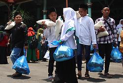 October 9, 2018 - Madiun, East Java, Indonesia - Participants who receive compensation from the Regional Government bring the goods, which are packages of basic needs when they leave the Graha Pendopo Muda in Madiun Regency. A total of 600 orphans and orphans in Madiun Regency received basic food packages and pocket money from the Madiun District Government which was handed over directly by Ahmad Dawami Regent Ragil Saputro (Credit Image: © Ajun Ally/Pacific Press via ZUMA Wire)
