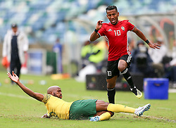 Durban. 080918. Molielo Vincent Pule of South Africa and Hamdou Elhouni of Libya battles for the the ball during the 2019 Africa Cup of Nations qualifying match between South Africa and Libya at Moses Mabhida Stadiium in Durban,South Africa. Picture Leon Lestrade. African News Agency. ( ANA ).