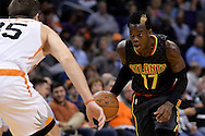 Jan 23, 2016; Phoenix, AZ, USA; Atlanta Hawks guard Dennis Schroder (17) handles the basketball in front of Phoenix Suns forward Mirza Teletovic (35) in the second half at Talking Stick Resort Arena. The Suns won 98-95. Mandatory Credit: Jennifer Stewart-USA TODAY Sports