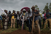 Joel Tuysenge, 17, places a memorial cross into the ground during the burial of his brother Emmanuel Cyuzuzo, 22, who passed away before receiving surgery to replace his aortic valve.<br /> <br /> Rheumatic heart disease is damage to one or more heart valves that stems from inadequately treated strep throat. Left untreated, rheumatic heart disease leads to heart failure.