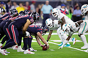 The Houston Texans offensive line gets set to snap the ball at the line of scrimmage opposite the Miami Dolphins defensive line during the NFL week 8 regular season football game against the Miami Dolphins on Thursday, Oct. 25, 2018 in Houston. The Texans won the game 42-23. (©Paul Anthony Spinelli)