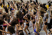 Baltimore Ravens cheerleader hopefuls perform during the first day of tryouts for the Ravens cheerleaders in Baltimore, Maryland, March 5, 2011.