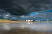 Almost Spielberg-like, the most incredible dark clouds built above a small cluster of beachside houses at Rhosneigr. Late afternoon sunlight burst under the weather front illuminating the coastline, increasing the drama further.