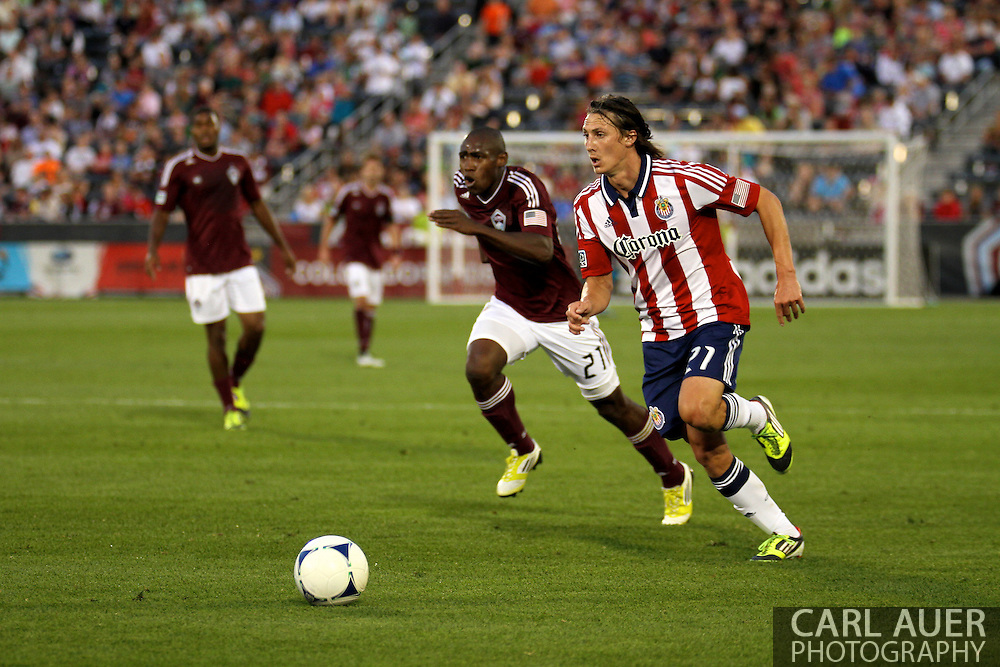 August 18th, 2012: Chivas USA midfielder Ben Zemanski (21) chases after the ball with Colorado Rapids defender Luis Zapata (21) following after him in the first half at Dick's Sporting Goods Park