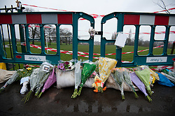 © Licensed to London News Pictures. 28/12/2012. Sheffield, UK. Flowers laid in the spot where a man was murdered on Greengate Lane, Sheffield. Alan Greaves, 68, was murdered near his home while making his way back from church. Photo credit: David Mirzoeff/LNP