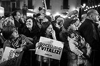 """CATANIA, ITALY - 28 OCTOBER 2017: Supporters of the  Five Star Movement (Italian: Movimento 5 Stelle, or M5S) candidate Giancarlo Cancelleri, running for governor of Sicily in the upcoming Sicilan regional election, hold the signs """"Choose the future"""" and """"Cancel life annuities"""" as they listen to his speech during a rally in Catania, Italy, on October 28th 2017. <br /> <br /> The Sicilian regional election for the renewal of the Sicilian Regional Assembly and the election of the President of Sicily will be held on 5th November 2017."""
