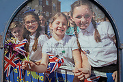 Summer scenes in a cracked window of the 'Age Concern' charity, showing an event in the London suburb of Swanley in which Winter Olympic Skeleton medallist Lizzie Yarnold paraded her medal around Kent towns in 2018, on 3rd February 2020, in London, England.