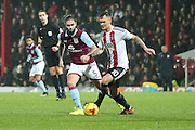 Aston Villa midfielder Henri Lansbury (5) Brentford Brentford midfielder Josh McEachran (10) during the EFL Sky Bet Championship match between Brentford and Aston Villa at Griffin Park, London, England on 31 January 2017. Photo by Matthew Redman.