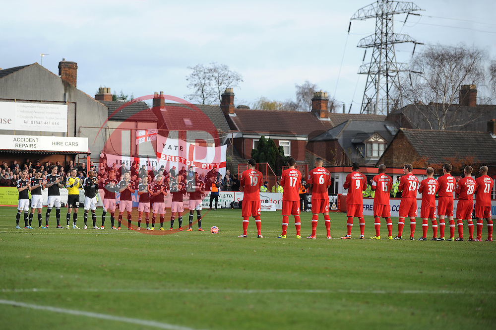 The teams partake in a minutes applause before the game - Photo mandatory by-line: Dougie Allward/JMP - Tel: Mobile: 07966 386802 08/12/2013 - SPORT - Football - Tamworth - The Lamb Ground - Tamworth v Bristol City - FA Cup - Second Round