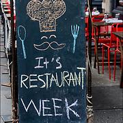 """""""It's Restaurant Week"""" outdoor blackboard restaurant sign in Greenwhich Village."""