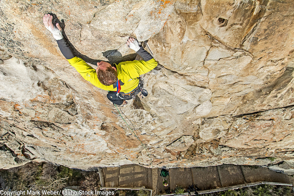 Elijah Weber rock climbing a route called Colossus which is rated 5,10 and located on Bath Rock at the City Of Rocks National Reserve near the town of Almo in southern Idaho