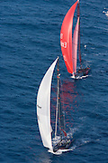 Team Alinghi and Team New Zealand racing the 32nd America's Cup, race 3