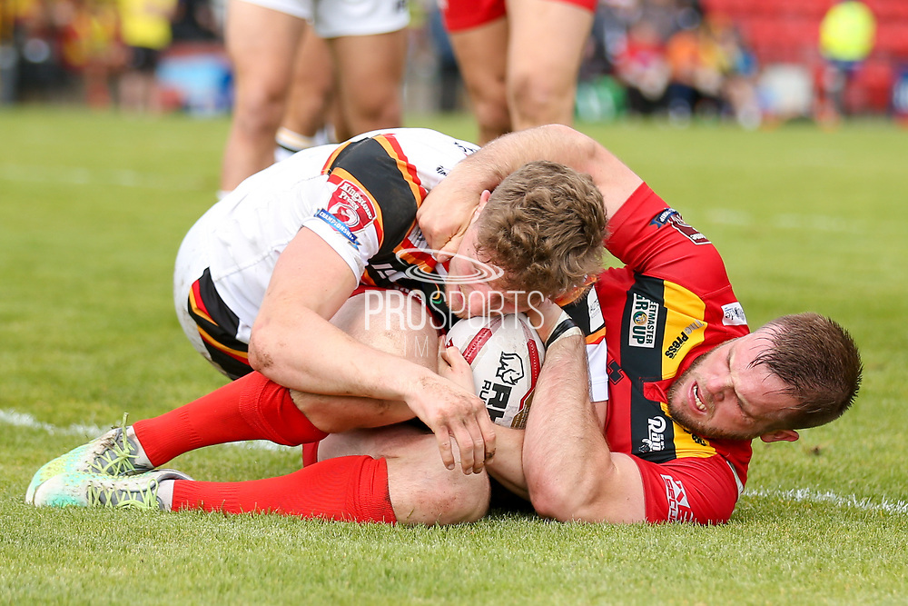 Bradford Bulls stand off Joe Keyes (7) is held up over the Dewsbury Rams try line during the Kingstone Press Championship match between Dewsbury Rams and Bradford Bulls at the Tetley's Stadium, Dewsbury, United Kingdom on 10 September 2017. Photo by Simon Davies.