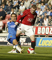 Photo: Aidan Ellis.<br /> Wigan Athletic v Manchester United. The Barclays Premiership. 14/10/2006.<br /> Wigan's Paul Scharner tackles United's Wayne Rooney