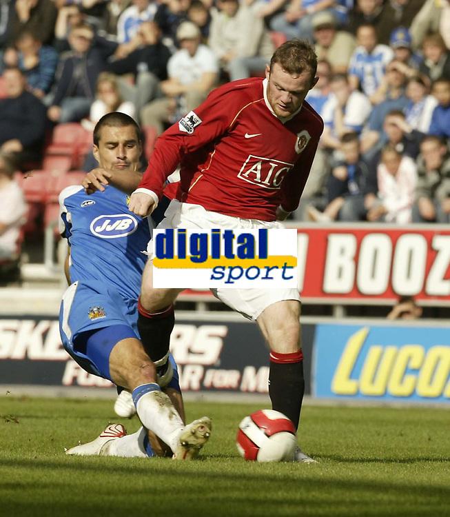 Photo: Aidan Ellis.<br /> Wigan Athletic v Manchester United. The Barclays Premiership. 14/10/2006.<br /> Wigan's Paul Scharner tackles United's Wayne Rooney