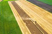Nederland, Groningen, Gemeente Vlagtwedde, 05-08-2014; Vledderkampen, graanoogst in de veenkolonien. De combine maait het graan en dorst dit direct, het zgn. maaidorsen. N<br /> Grain harvest in a peat landscape, East Netherlands (near German border). The combine reaps the grain and threases it. <br /> luchtfoto (toeslag op standard tarieven);<br /> aerial photo (additional fee required);<br /> copyright foto/photo Siebe Swart