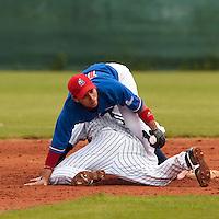 03 June 2010: Daniel Sanchez of C.B. Sant Boi fails to tag out Kenji Hagiwara of Rouen during the 2010 Baseball European Cup match won  8-4 by C.B. Sant Boi over the Rouen Huskies, at the Kravi Hora ballpark, in Brno, Czech Republic.