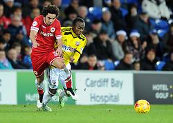 Cardiff City's Fabio Da Silva and Brentford's Moses Odubajo compete for the ball - Photo mandatory by-line: Paul Knight/JMP - Mobile: 07966 386802 - 20/12/2014 - SPORT - Football - Cardiff - Cardiff City Stadium - Cardiff City v Brentford - Sky Bet Championship