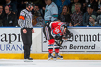 KELOWNA, CANADA - DECEMBER 3: Conner Bruggen-Cate #20 of the Kelowna Rockets stands at the boards with referee Jeff Ingram after a line brawl with the Brandon Wheat Kings on December 3, 2016 at Prospera Place in Kelowna, British Columbia, Canada.  (Photo by Marissa Baecker/Shoot the Breeze)  *** Local Caption ***