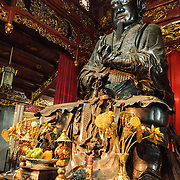 A large bronze statue at Quan Thanh Temple in Hanoi. The statue, measuring nearly 4 meters tall and weighing nearly 4 tons was cast in 1677 and depicts Huyen Thien Tran Vo, the God who administered the North and after whom the temple was originally named. The Taoist temple dates back to the 11th century and is located close to West Lake (Ho Tay).