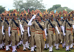 August 28, 2017 - Bhubaneswar, India - Newly recruited constables of the first batch State Industrial Security Force take salute to the national flag of India after taking oath in their passing out parade in the eastern Indian state Odisha's capital city Bhubaneswar. Women also take opportunity to join this department security forces to operate airport, port, industries and banks in all over the state. (Credit Image: © Str/NurPhoto via ZUMA Press)