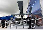 "Company employees at defence, security and aerospace company Thales' exhibition stand at the Farnborough Air Show. The MoD's newest and most sophisticated surveillance and targeting drone, the Watchkeeper, is undergoing trials at Aberporth in west Wales. While the arguments over America's policy of ""assassination by drone"" rage across Pakistan and Afghanistan, fuelling public concern over the cold-eyed automation of warfare, the future of UAVs is quietly taking shape here on the Welsh coast, where there is daily proof that UAVs and manned aircraft can co-exist in British airspace."
