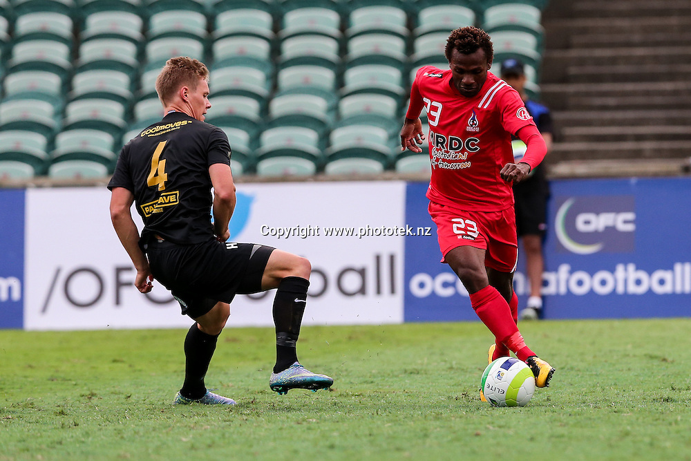 Hekari's Joses Nawo tries to go aroundvTeam Wellington's Anthony Hobbs . OFC Champions League 2016 Group Stage, Team Wellington v Hekari United, QBE Stadium, Auckland, Saturday 16th April 2016. Photo: David Joseph / www.phototek.nz