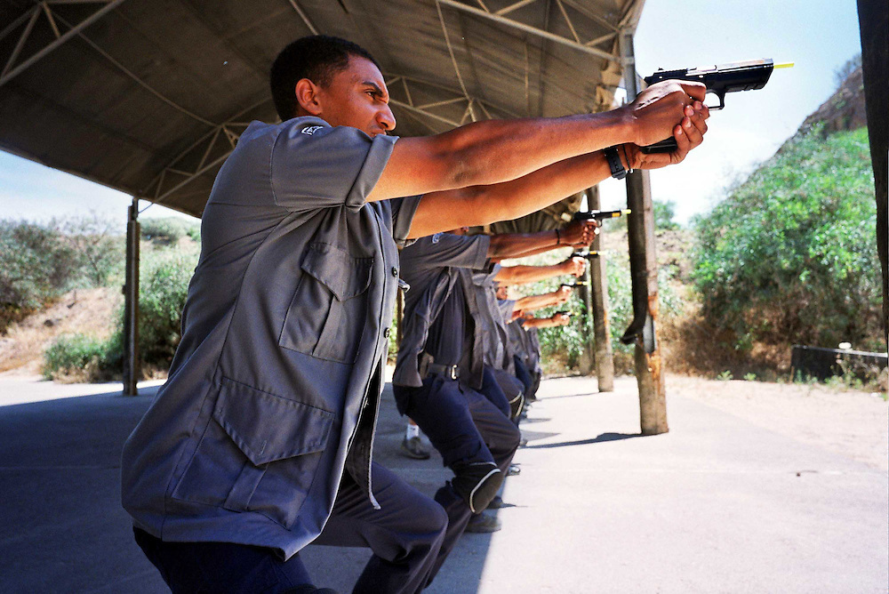 Caesarea 10.nov2003 ..Public places in Israel become to be the main target for Palestinian terrorist...Israelis Businesses employ private company that gives them a security serves...Security team on training near the city Caesarea...